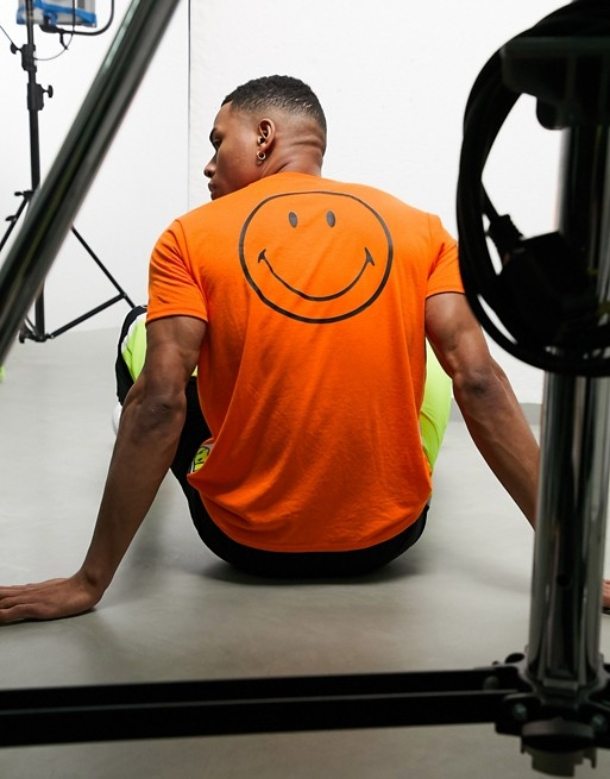 ellesse x Smiley Rapallo t-shirt in neon orange
