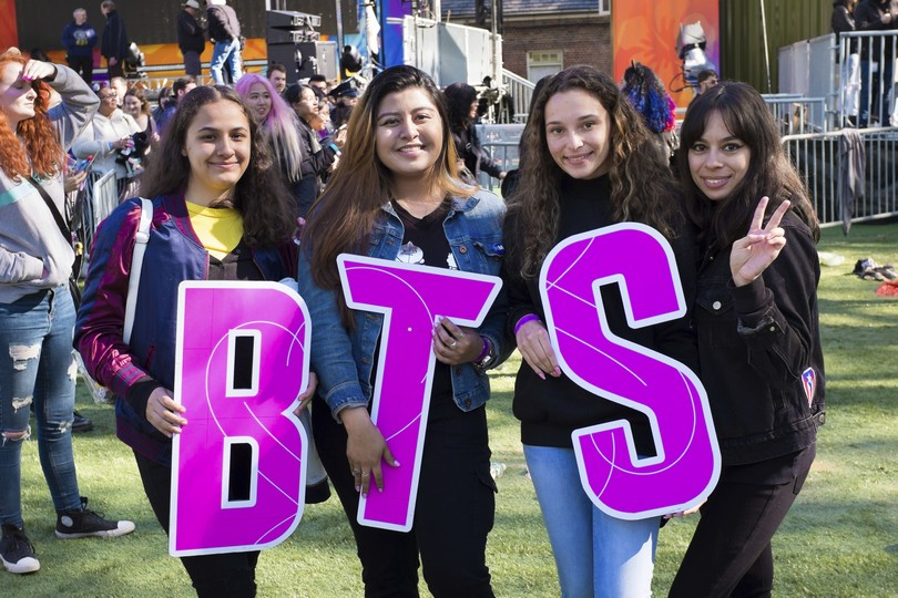 """Fans of South Korean boy band BTS attend a concert on ABC's """"Good Morning America at Rumsey Playfield/SummerStage in Central Park on Wednesday, May 15, 2019, in New York. (Photo by Scott Roth/Invision/AP)"""