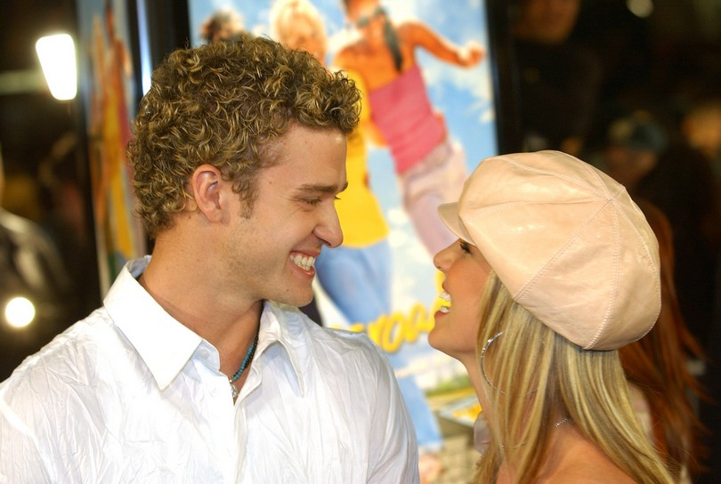 "Pop star Britney Spears, right, star of the new film ""Crossroads,"" shares a laugh with her boyfriend Justin Timberlake of the pop group 'N Sync at the premiere of the film at the Grauman's Chinese Theater in the Hollywood section of Los Angeles, Monday, Feb. 11, 2002. (AP Photo/Chris Pizzello)"
