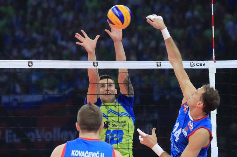 Serbia's Aleksandar Atanasijevic, right, spikes the ball against Slovenia's Klemen Cebulj, center, during a European Volleyball Championship final match between Serbia and Slovenia at the AccorHotels Arena in Paris, Sunday, Sept. 29, 2019